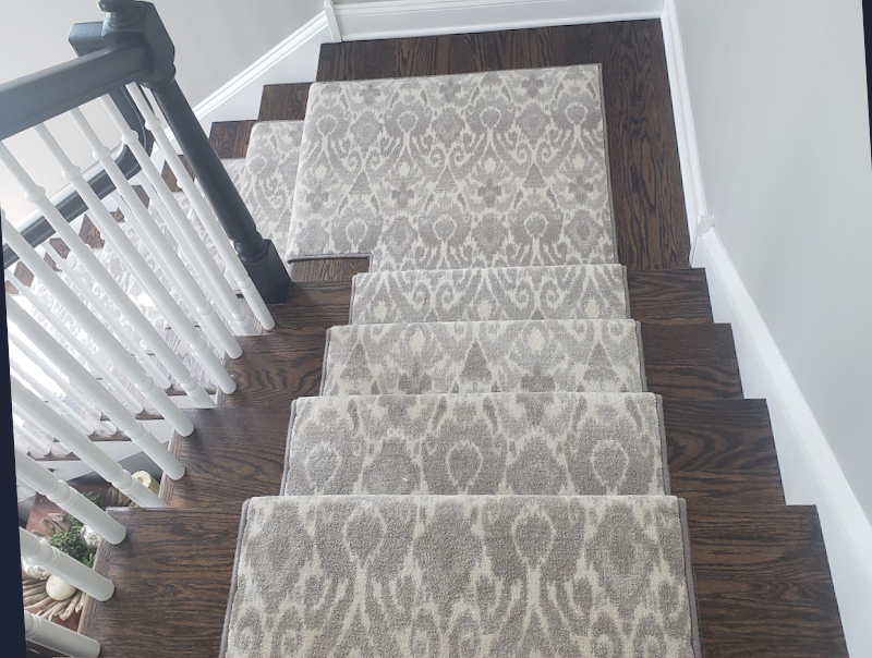 gray stair runner on hardwood steps top