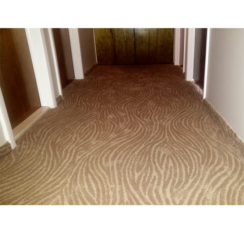 Wave pattern carpet installed in hall